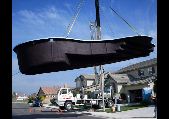 40 ton crane lifting a pool